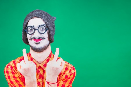 Mime poses and grimaces in the studio Banco de Imagens