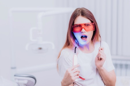 girl orthodontist posing with instruments in the clinic