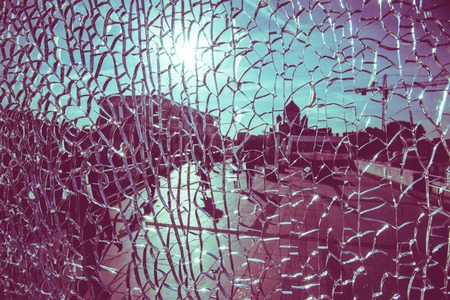 view through cracked glass on a sunny day in Moscow