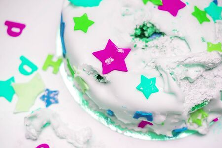 a birthday cake for a little baby who broke it 写真素材