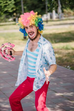 Mime performs a pantomime on the street with balloons.