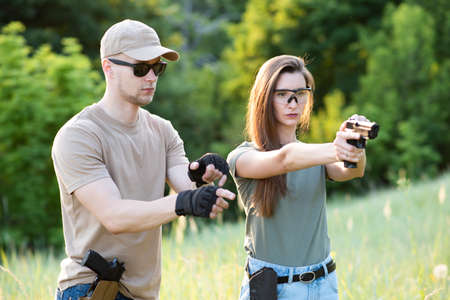 The shooting instructor teaches the backslider how to handle a weapon