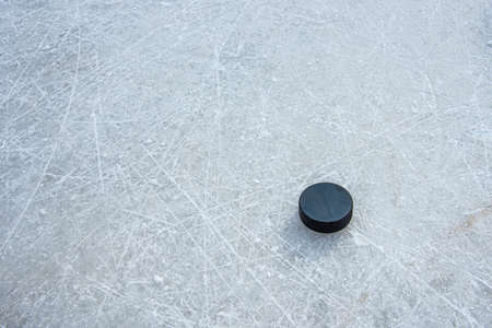hockey puck lies on the snow macro Stock fotó