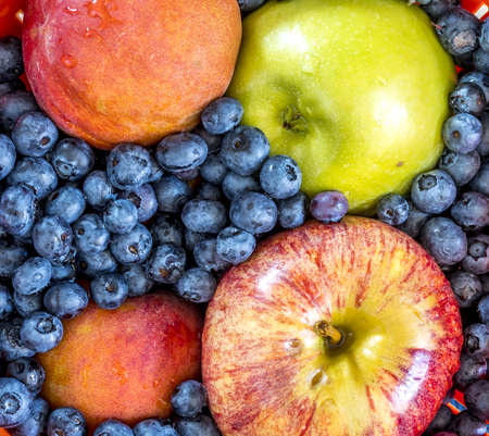 Blueberries and apples in studio setting in close up Stock Photo