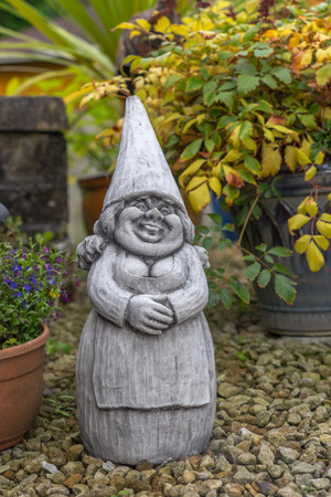 garden gnome: Happy female garden gnome. Stock Photo