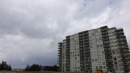 Clouds in the sky. Various shapes, sizes, and scenes. Modern Apartment Building/real estate included.
