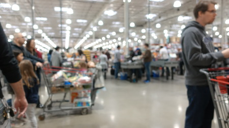 Blurred Out People In Big Box Retailer Shopping