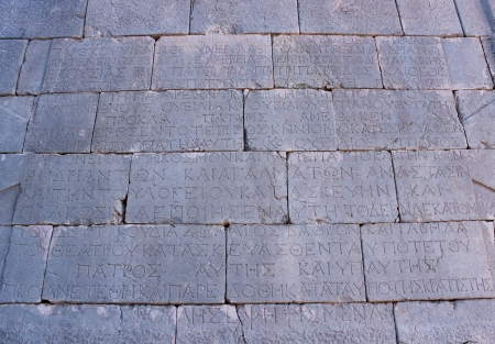 grec antique: Texte grec antique sur le mur � Patara Turquie