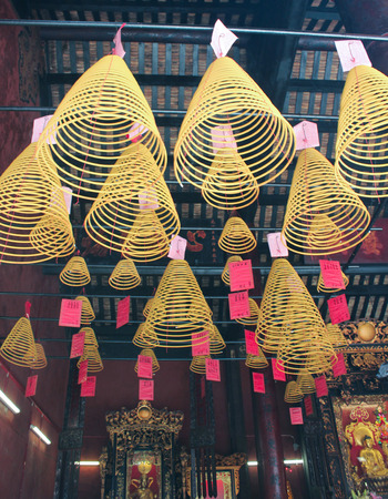 candleholders: View with Chinese Candles in  Lin Fung Temple  Temple of Lotus  in Macau Stock Photo