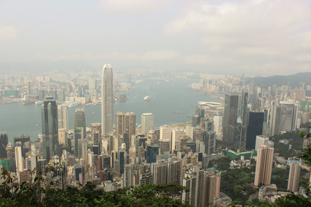 The view of Central, Kowloon and Victoria Harbour from Victoria Gap, near the top of Victoria Peak on April 2014 in Hong Kong