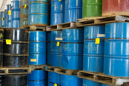 hazardous waste: Colorful stacked oil barrels
