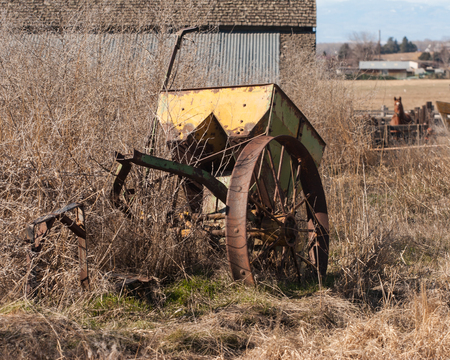 farm equipment: Old yellow farm equipment
