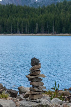 Small cairn stones by a lake