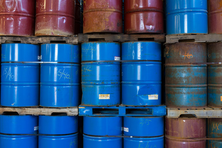 hazardous waste: Rows of colorful stacked oil barrels