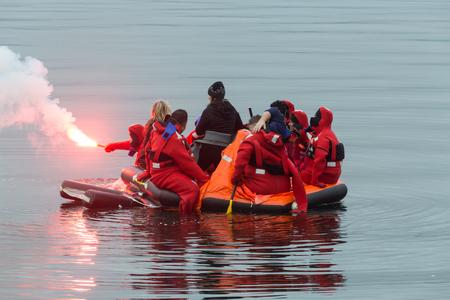 Sailors in a lifeboat Reklamní fotografie