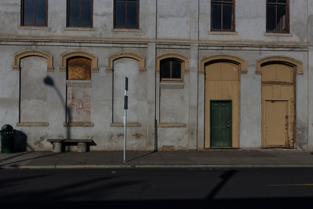 Old white building with a green door Stock fotó
