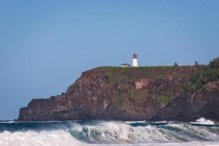 Kilauea lighthouse on the rocks jutting out into the Pacific Ocean Kauai, Hawaii Stock Photo