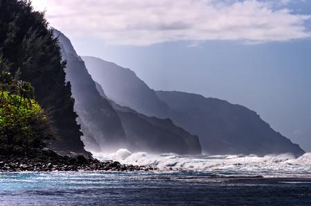 waves crashing: Waves crashing on Na Pali Coast Beach Stock Photo