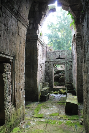 buddhist temple: Taking shelter from the rain among the ancient ruins near Angkor Wat, Siem Reap, Cambodia