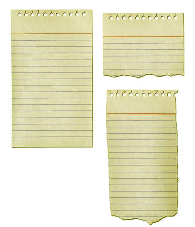 yellowed: Old notepad paper ripped and yellowed.