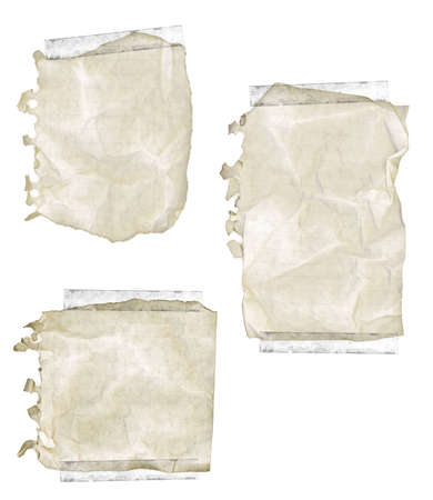 Collection of old yellowed ripped and wrinkled notepad paper with tape. photo