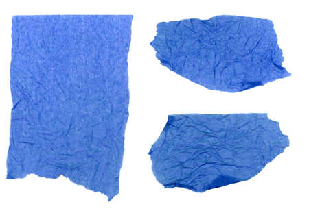 Three pieces of blue tissue paper ripped, wrinkled and torn, isolated on a white background.