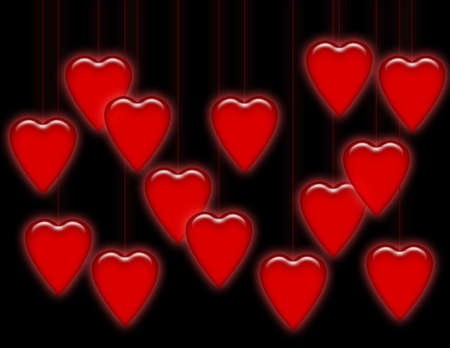 Shiny red hearts hanging from strings on a black background.