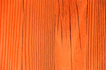 Close shot of red textured worn and weathered wood