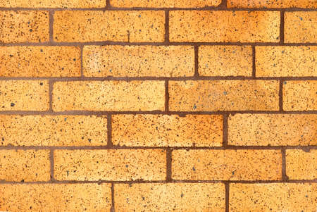 Dirty yellow brick wall background Reklamní fotografie