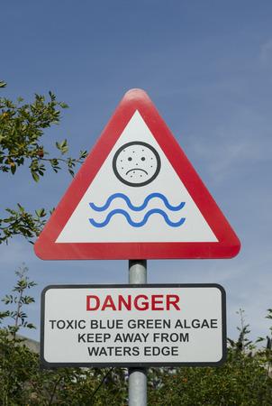 poisoned: Warning sign for toixic blue green algae