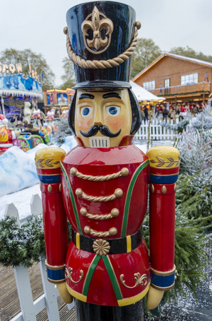 A lifesize toy soldier in a wintery Christmas setting photo