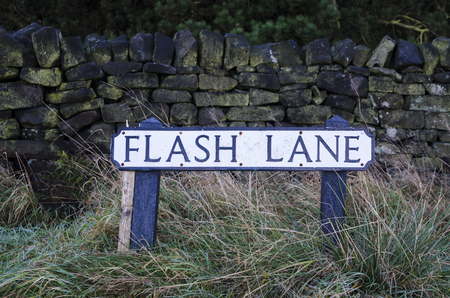 unusually: Roadsign on a road unusually called Flash Lane
