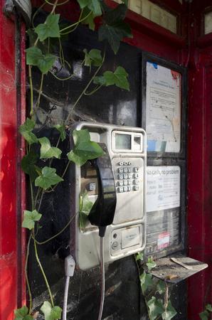 disused: English disused telephone box - close up detail Stock Photo