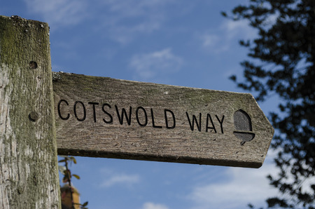 Wooden signpost pointing the direction of the Cotswold Way footpath Imagens