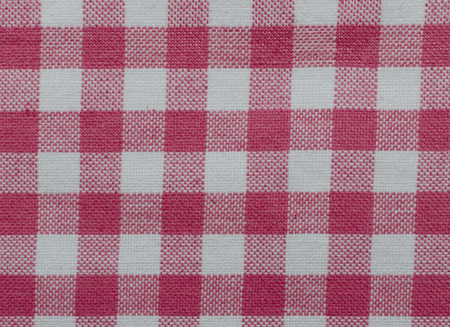 Material for a tea towel or table cloth with a checkered red and white pattern