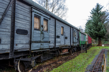 A line of old, disused wooden railway carriages
