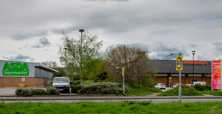 Flint, Wales, 01st May 2018. Asda and Sainsbury who have announced a potential merger with no store closures are neighbours in the North Wales town of Flint. Their respective supermarkets are divided
