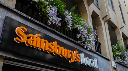 Chester, UK: Aug 6, 2018: The Sainsbury's Local logo on a sign above their store in the centre of Chester
