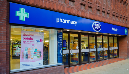 Chester, UK: Aug 6, 2018: Boots is a chain of pharmacy stores in the UK which has shops in most town and city centres such as this one in Chester. They are advertising a double points promotion. Publikacyjne