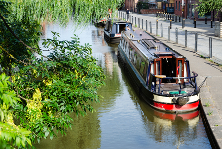 Chester, UK: Aug 6, 2018: The Shropshire Union Canal passes through Chester. The city is a popular place for narrow boats to moor. Editorial