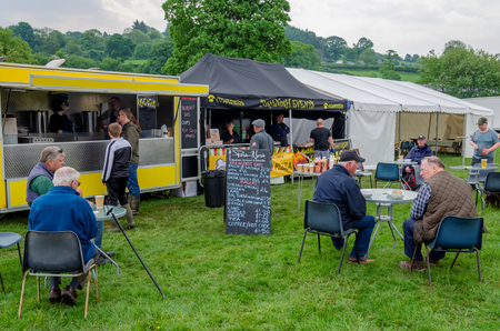 Bala Lake, UK: May 27, 2018: Despite the poor weather, The Festival of Transport saw a good turn out of classic cars, tractors, bikes, Landrovers, commercial vehicles, side stalls & traders. Imagens - 120450702