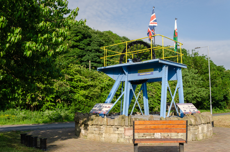 Ffynnongroyw, UK: June 3, 2018: A headgear from the nearby Point of Ayr colliery is a lasting memorial. The pit was the last deep pit in North Wales when it closed in 1996. Standard-Bild - 120450724