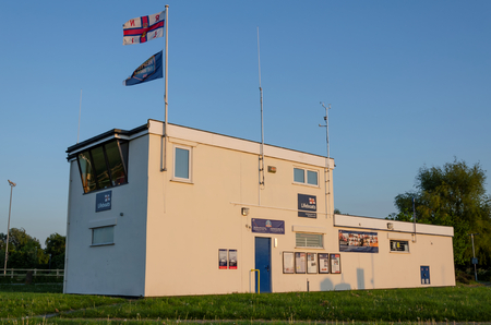 Flint, UK: May 22, 2018: Flint lifeboat station which is operated by the RNLI. The station is home to a D class lifeboat. The door to the boathouse faces away from the sea, which is unique in Wales.