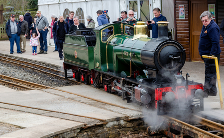 Shelley, UK: April 8, 2018: People enjoy a day out at a narrow gauge steam railway.