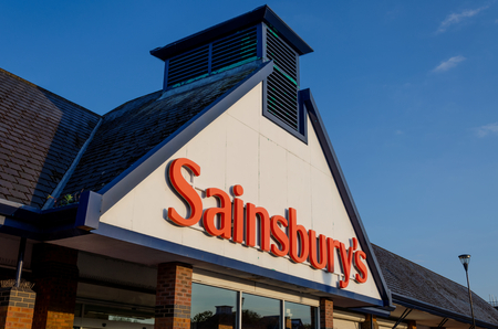 Flint, UK: May 22, 2018: Sainsbury's store in Flint. Sainsbury's who are in the process of merging with Asda have recently restructured their staffing and pay grades.
