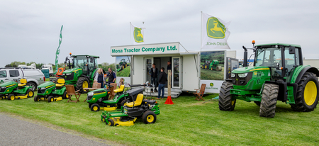 Anglesey, UK: Feb 20, 2018: Display of agricultural tractors and ride on lawn mowers from the Mona Tractor Company Ltd at the Anglesey Vintage Rally. Editorial