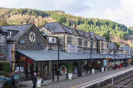 Betws y Coed, UK - Feb 12, 2019: People standing on the platform of Betws y Coed railway station on a bright February day.