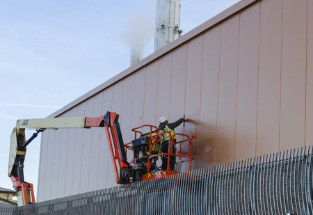 Rhyl, UK. January 9, 2019. Workers use a hydraluic access platform to clean the panelled walls of the New SC2. The SC2 replaces Rhyls original Sun Centre.
