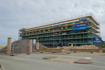 Rhyl, UK: June 3, 2018: Building work is underway on the new Travelodge which is being constructed on the promenade at Rhyl Imagens - 121227576