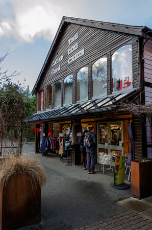 Betws y Coed, UK - Feb 2, 2019: The long established Log Cabin in Betws Y Coed is well known for its Welsh products, gifts and souvenirs. The building is constructed mostly of timber. Editorial